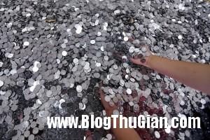 750px coins 7189 1400292355 300x200 Đem 5 tấn tiền xu mua oto