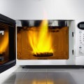 623-03284076 © Masterfile Royalty Free Model Release: No Property Release: No Fire in microwave